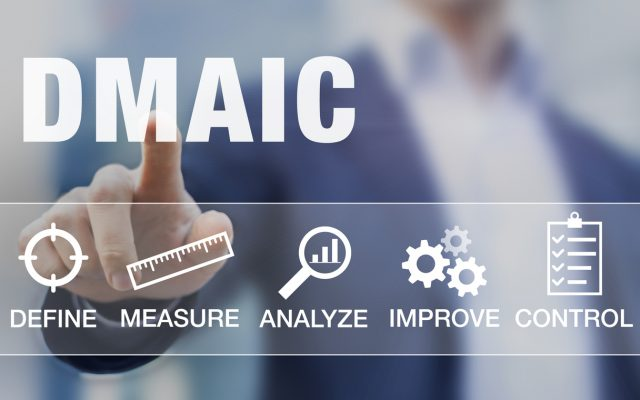 Manager presenting DMAIC continuous improvement tools